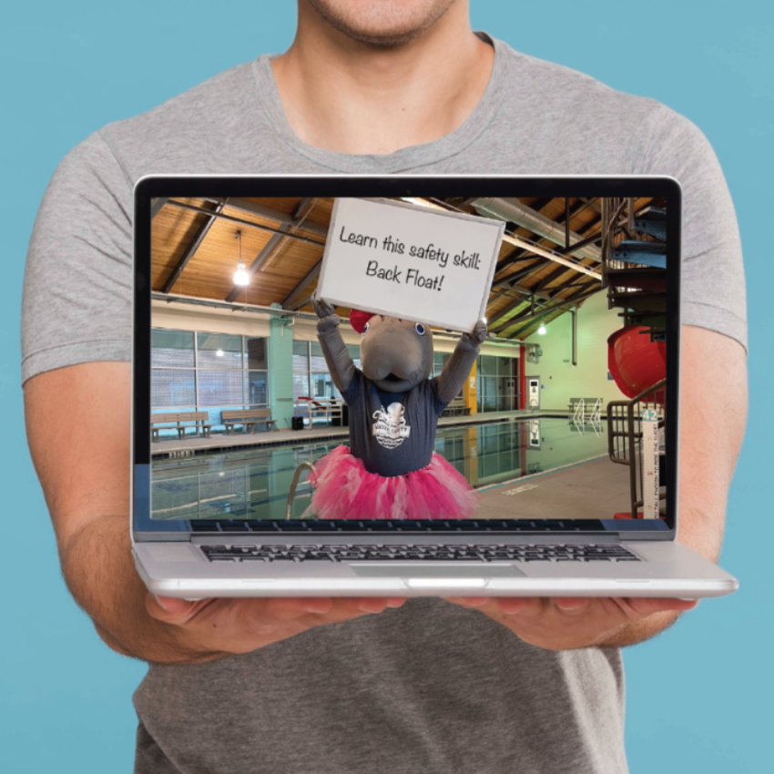 Image of a person holding a laptop